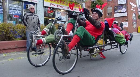 Carla and Dan pilot the Family Truckster in Santa Claus Parade