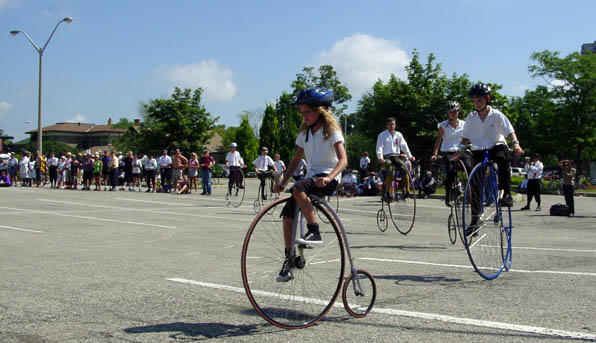 Children's formation riding on penny farthings