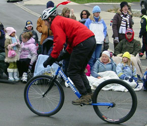 Oliver rides the Hulabike in the Santa Claus Parade