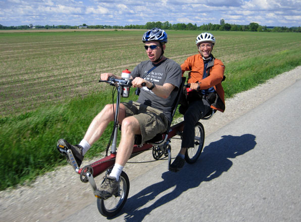 Brent and Boaz pedal the BikeE E2 recumbent tandem toward London